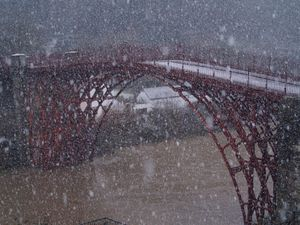 Snow falling in front of the Iron Bridge. Photo: Graham Hickman