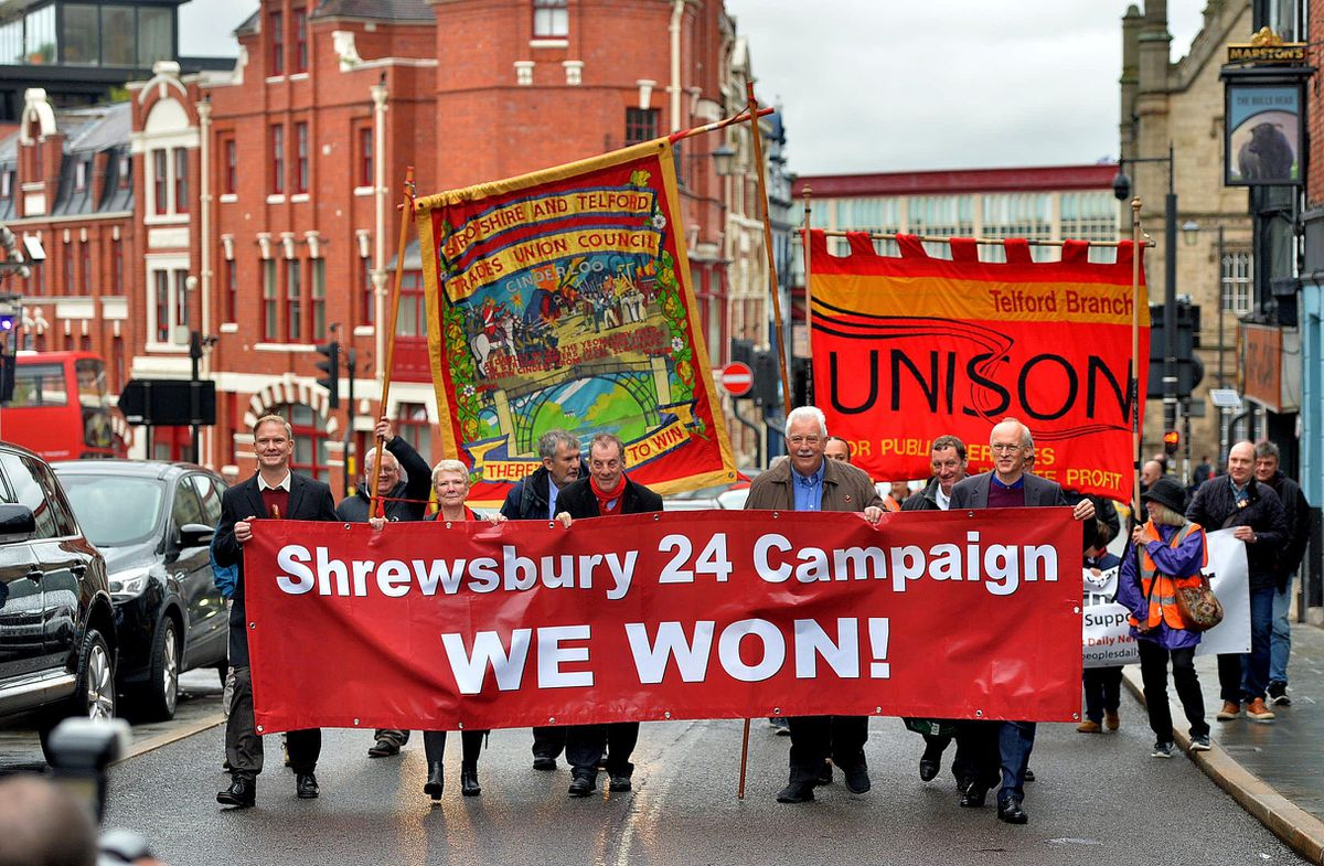 The group marched from Shrewsbury Railway Station to nearby St Nicholas Bar where the celebration was held