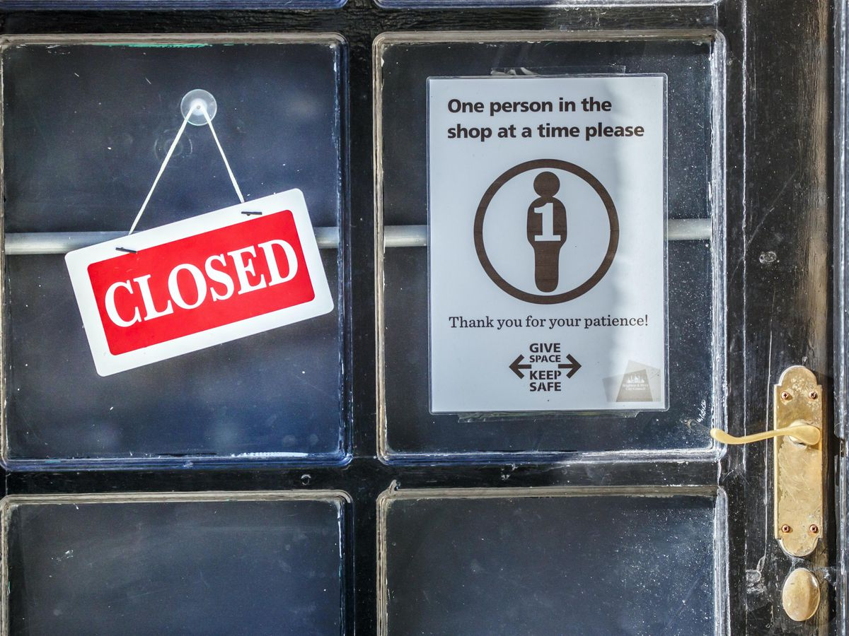 A 'Closed' sign on a shop door