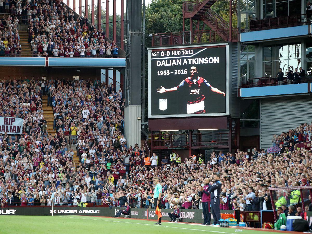 Fans applaud in memory of Dalian Atkinson