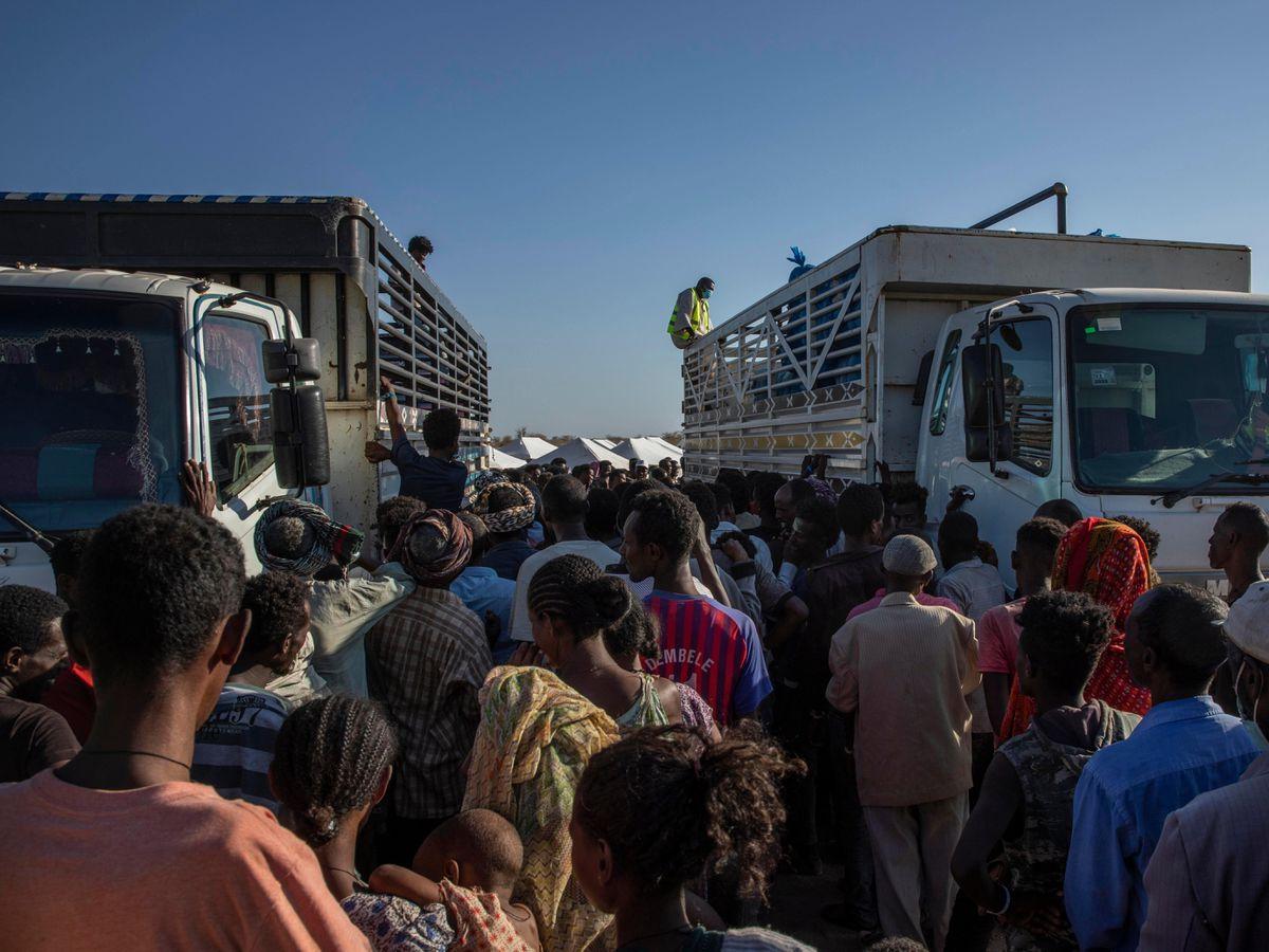 Tigray refugees who fled the conflict in Ethiopia's Tigray region, wait to receive aid at Umm Rakouba refugee camp in Qadarif, eastern Sudan (Nariman El-Mofty/AP)