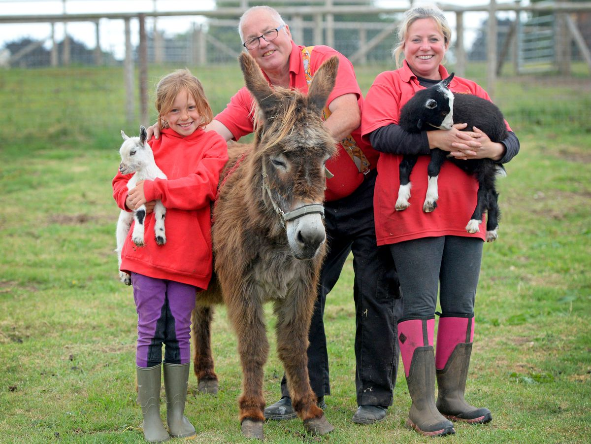 Tony Scott, of Scotty's Donkeys, with daughter Sarah and grandaughter Evie, seven