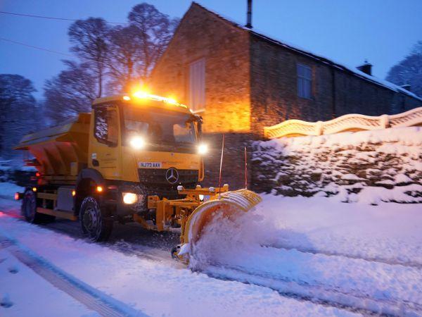 A snowplough clears heavy overnight snow