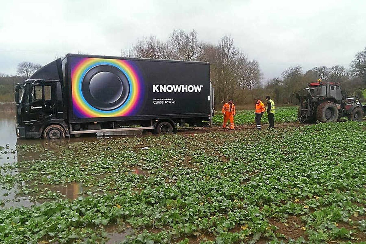 Delivery lorry gets stuck in flooded Shrewsbury field