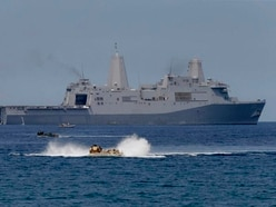 Beijing says US warship violated sovereignty in South China Sea