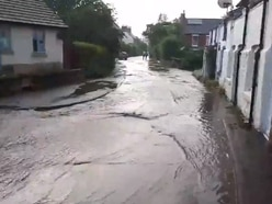 WATCH: Road turned to river as village becomes latest rain victim