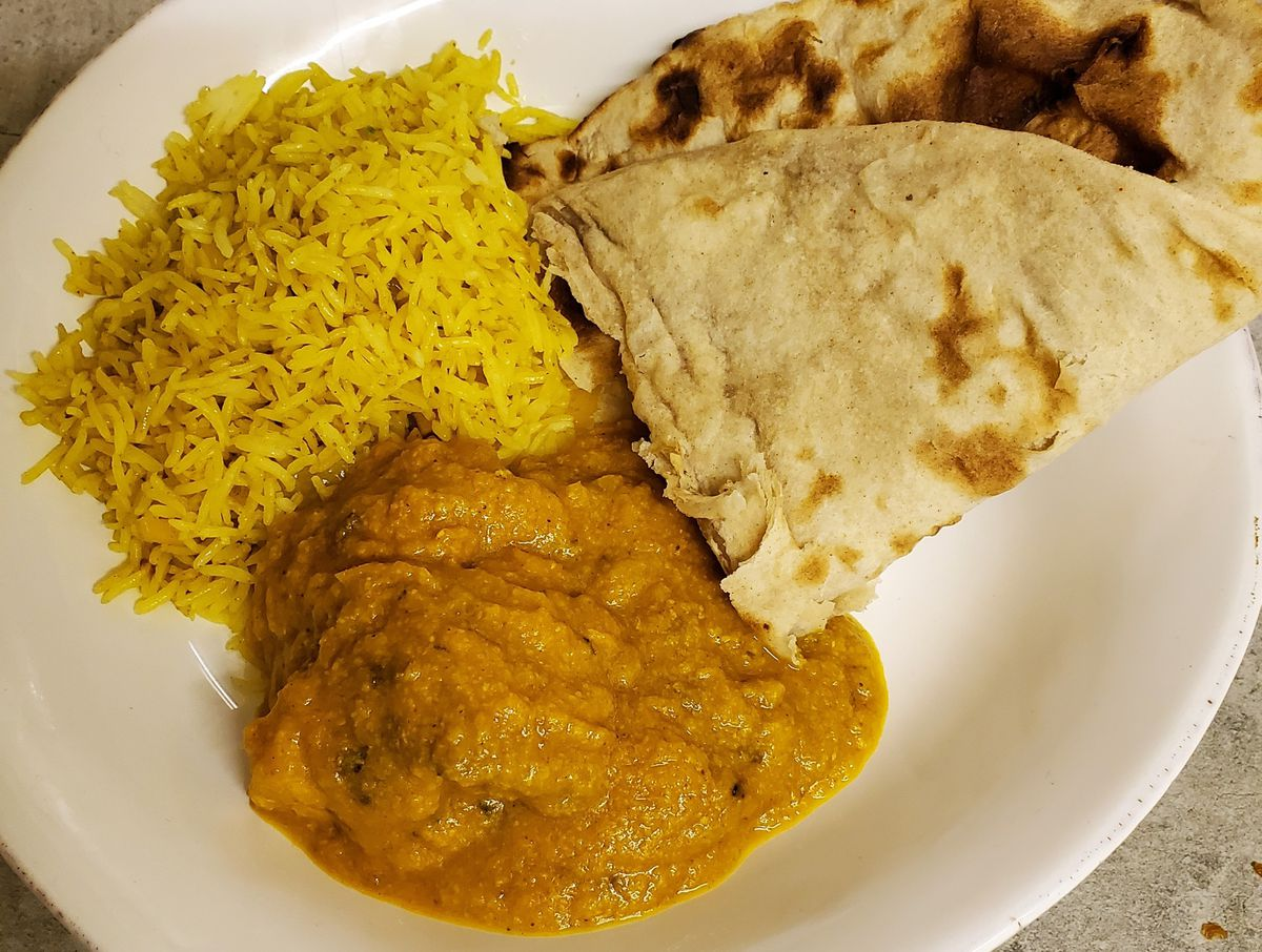 Coconut chilli chicken with roti and lemon rice