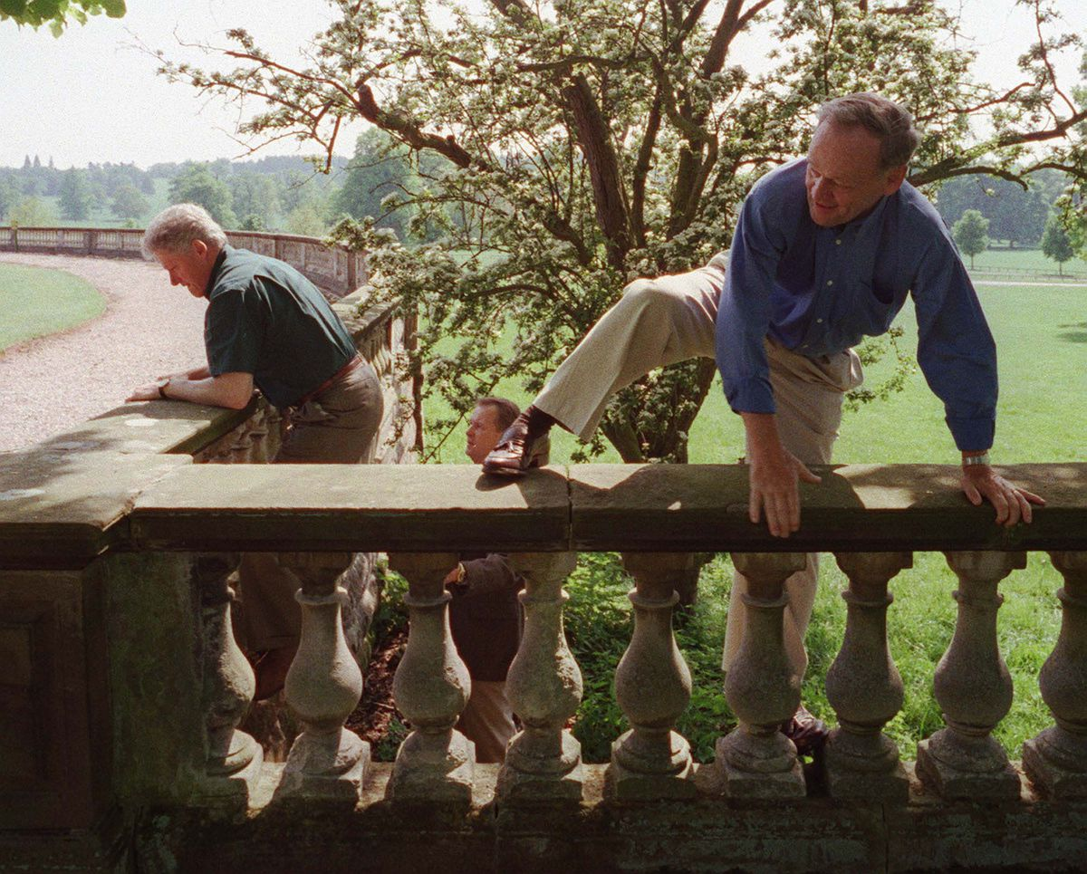 Canadian Prime Minister Jean Chretien, right, and US President Bill Clinton explore the Weston Park grounds