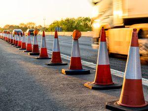 Evening view UK Motorway Services Roadworks Cones..