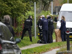 Police officers attend the scene after Peter Madsen was apprehended