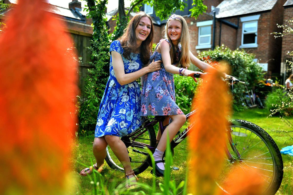 Ange Barre and Jessica Barre, aged 9, who is a young carer for her mom