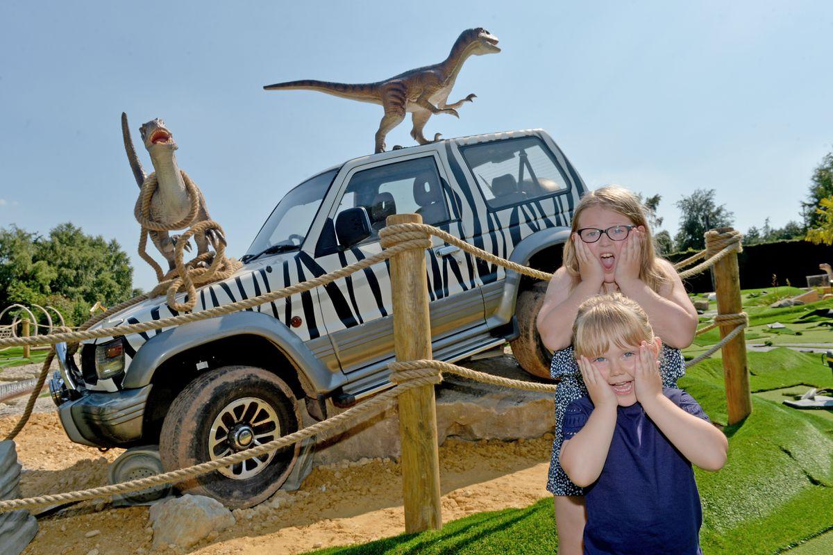 Sisters Poppy Rogers, nine, and Harriet, four, meet Wolverhampton Adventure Golf's resident velociraptors
