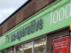 Co-op worker denies role in £40,000 fraud