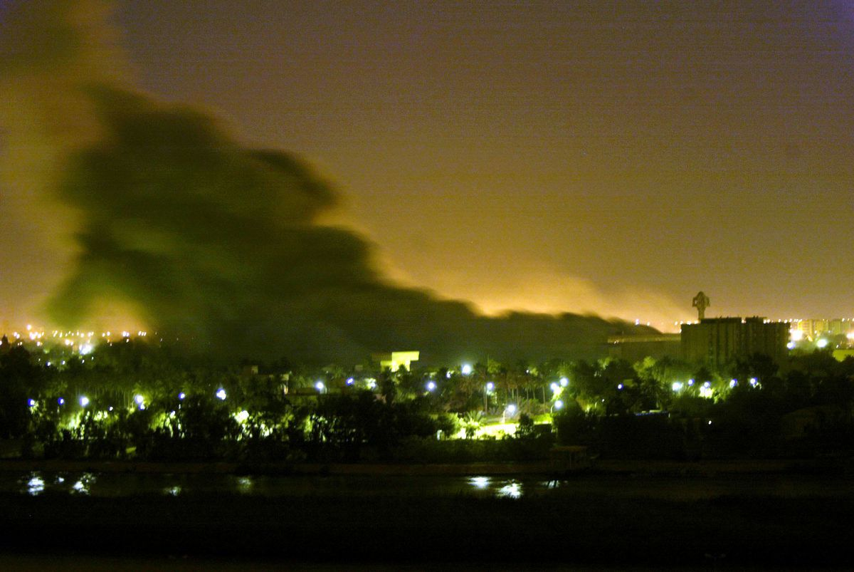 Smoke billows from a building hit during a coalition forces air raid in Baghdad Monday March 31, 2003