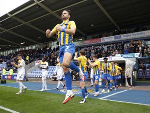 Luke Leahy of Shrewsbury Town jumps in the air as he enters the pitch before the game.