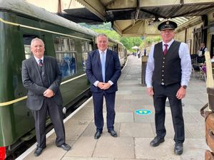 From left at the reopening of Llangollen Railway are Phil Coles, vice chairman of the Llangollen Railway Trust, Simon Baynes MP, and train guard John Doyle.
