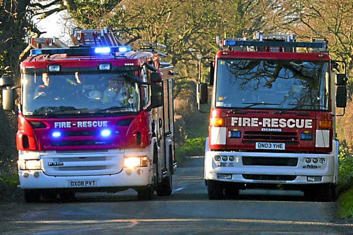 Fire crews tackle blaze at car workshop and stables on Shropshire border
