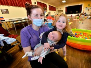 Emily Reeves, 22, with three-month-old son Charlie and daughter Rosie, two