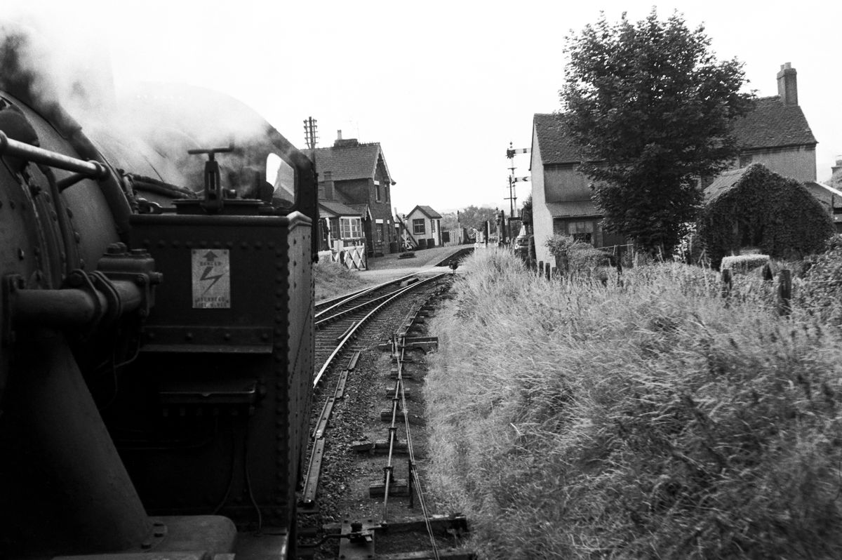 A loco approaches Ketley level crossing over the A5 and the station just beyond in the early 1960s.