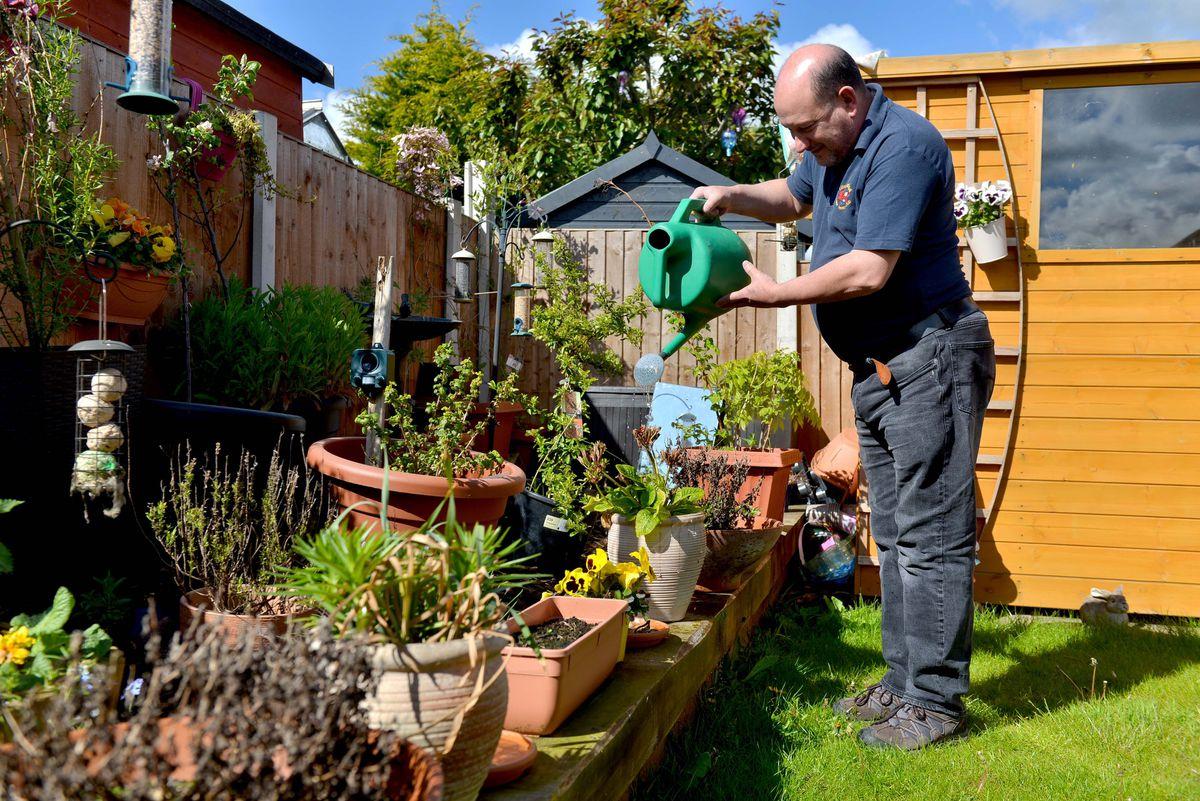 Donald Fear in his garden in Telford