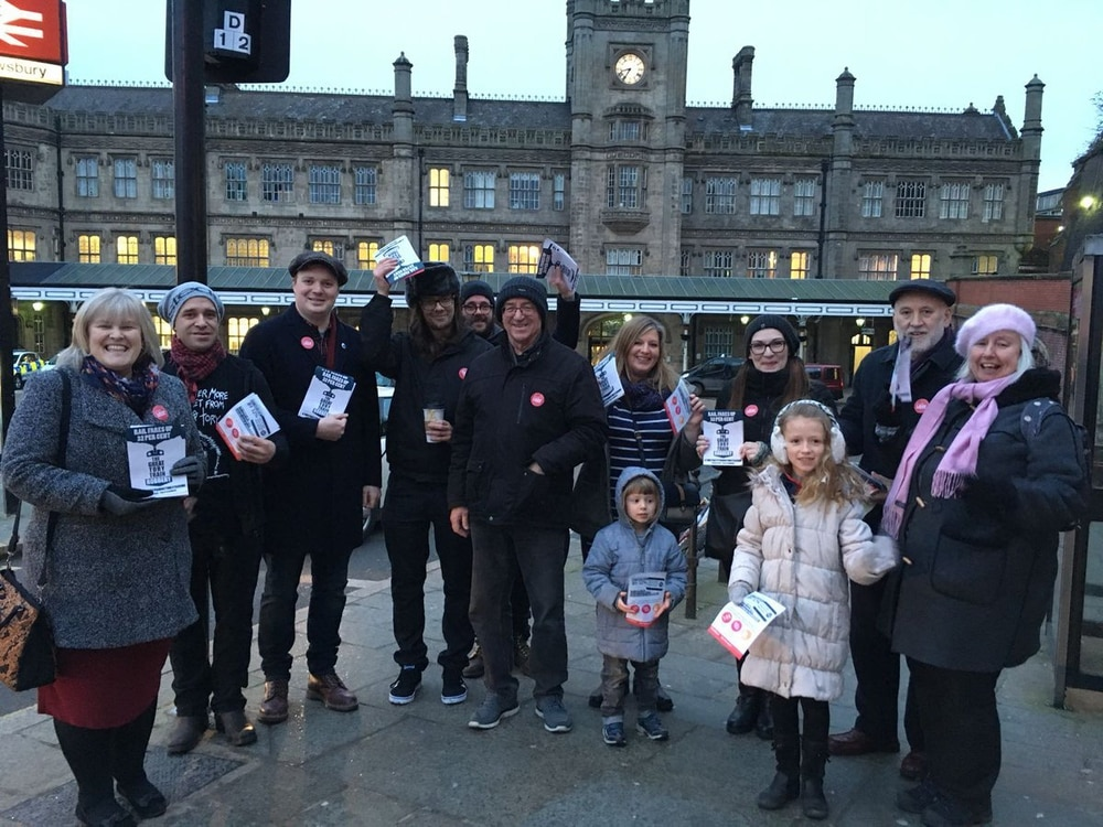 Labour Party supporters campaign outside Shrewsbury's railway station