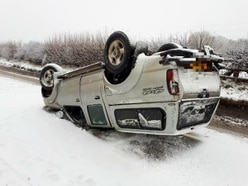 Driver escapes unharmed as 4x4 overturns in Oswestry snow