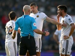 Conor Coady's verdict on 'sloppy' decisions during feisty Wolves draw at Bournemouth