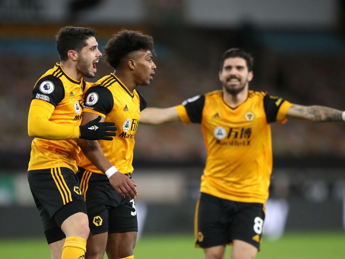 Wolverhampton Wanderers' Pedro Neto and Adama Traore celebrate (PA)