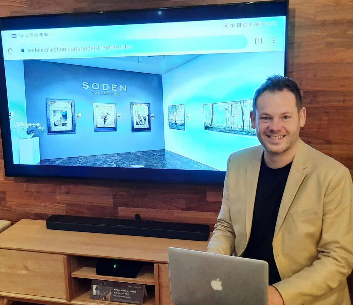 Jonathan Soden with his online gallery on screen