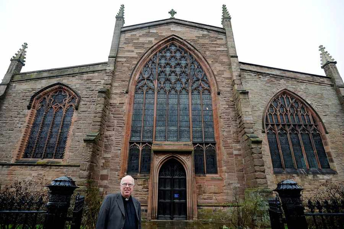 The Venerable Colin Williams outside S. Laurence's Church in Ludlow