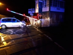 Shropshire level crossing closed after car smashes into barriers
