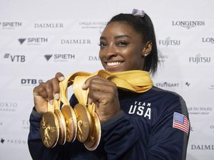 Simone Biles with some of her gold medals