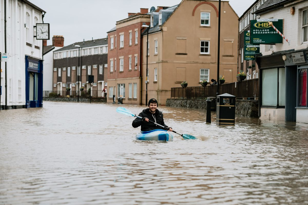 A canoeist takes to the water in flooded Coleham, Shrewsbury