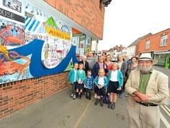 Eager volunteers unveil Ludlow Art Mural Project