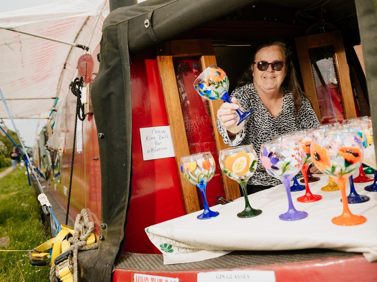 Wendy Baughan, from Wendy B's, travels from event to event selling paintings and hand-painted glassware from her narrowboat