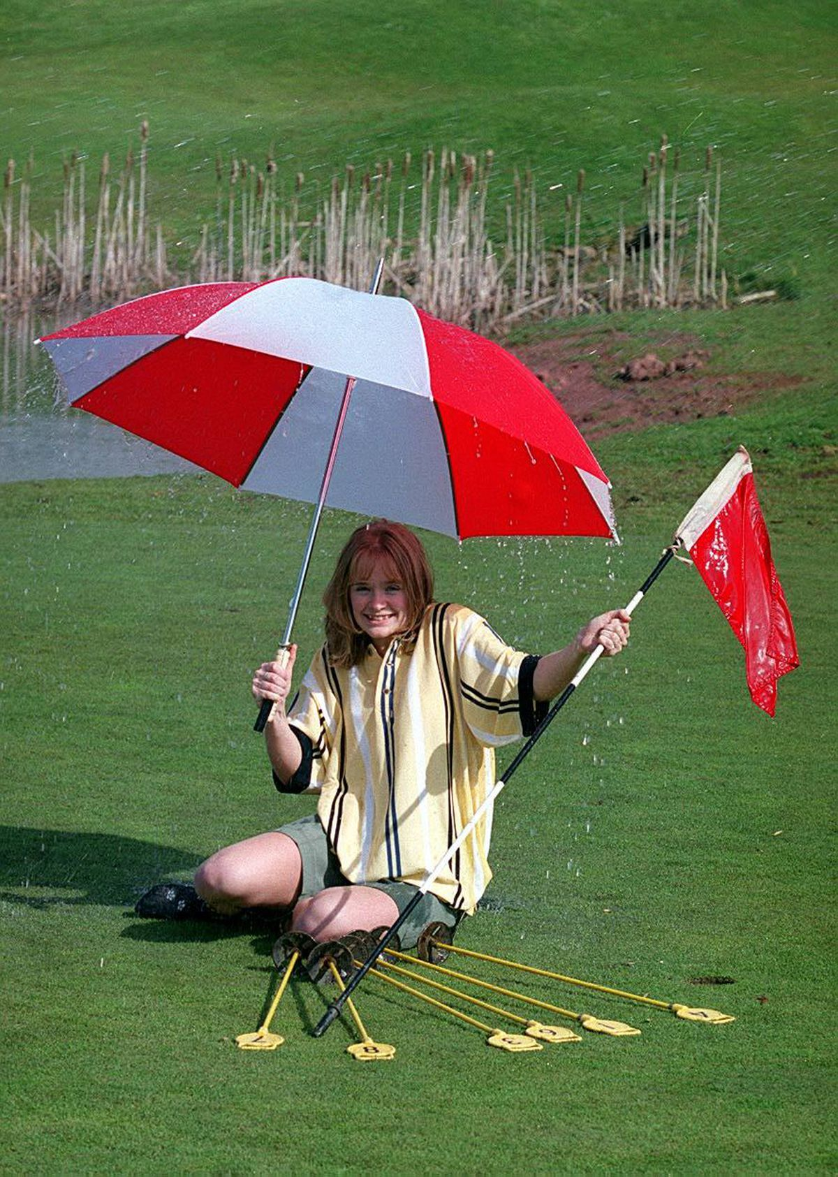 Trainee manager Claire Wall, then 18, under the sprinklers on the putting green at The Shropshire Golf complex at Muxton