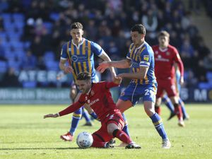 Luke Leahy of Walsall and Oliver Norburn of Shrewsbury Town.