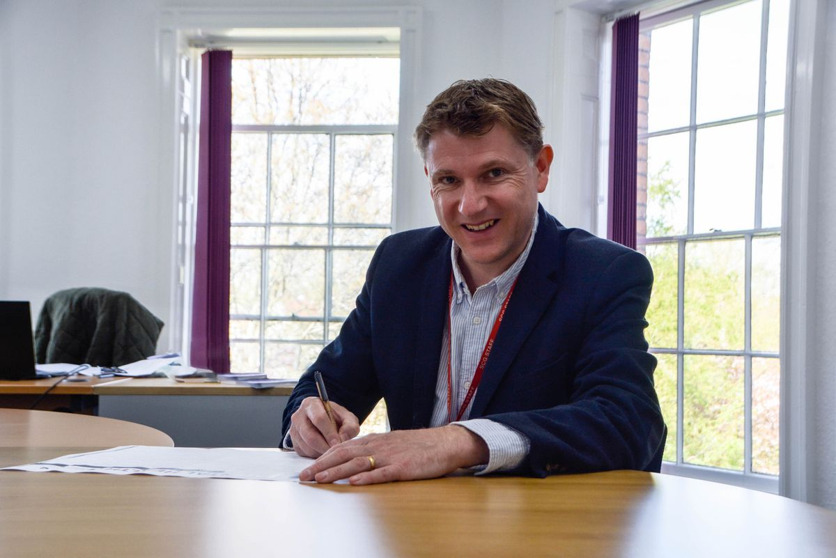 James Staniforth signing the charter