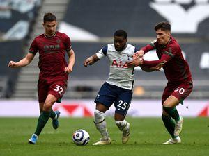 Tottenham Hotspur's Japhet Tanganga (centre) battles for the ball
