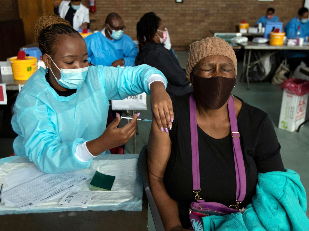 A woman receives a vaccine from a healthcare worker in South Africa