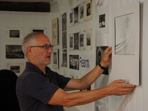 With the Harry Fearn exhibition is gallery assistant Bob Langridge.