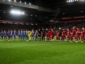 A general view as both teams line up at Anfield, home stadium of Liverpool.