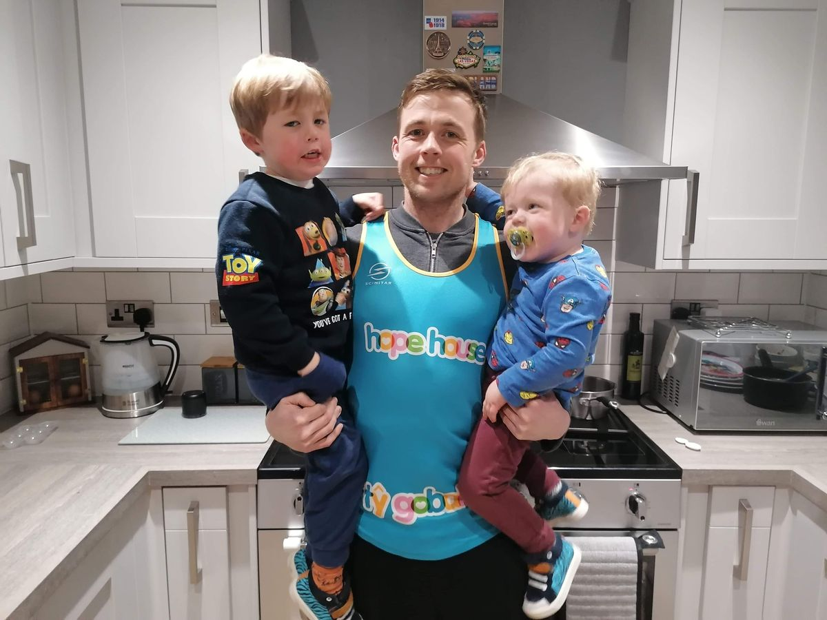 James with his two boys Arthur and Walter.