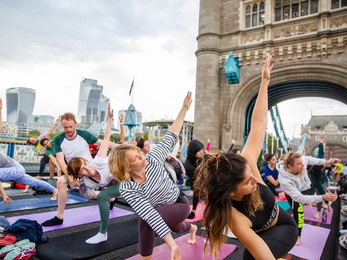Reimagine Sunrise Flow yoga takes place on Tower Bridge, kicking off Car Free Day on Sunday 22 September