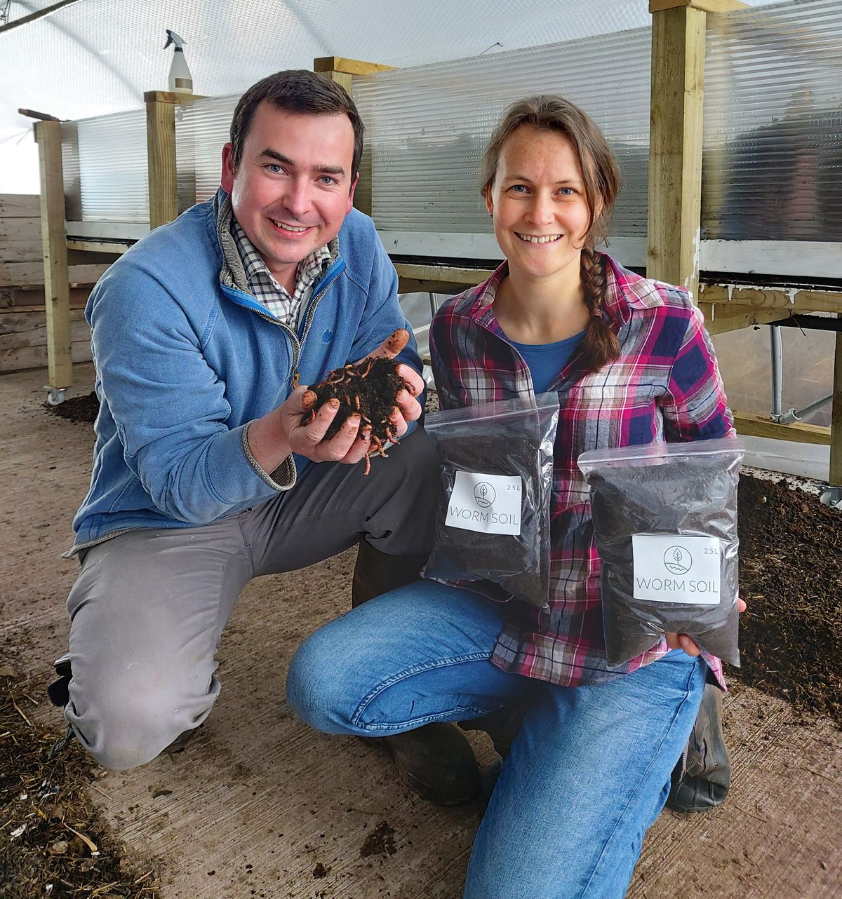 Down on the farm... Luke and Steph Boxall with their worm soil.