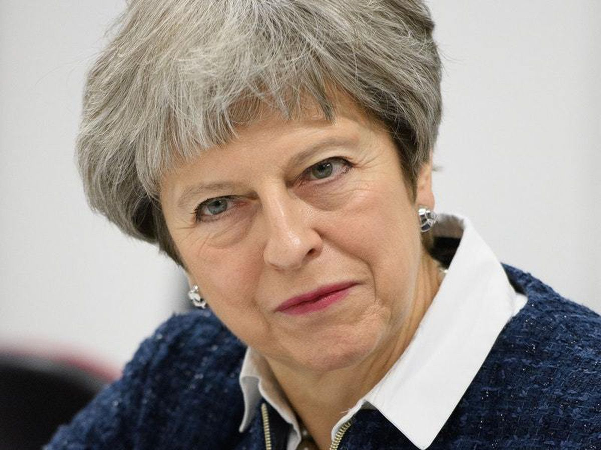 """Prime Minister Theresa May listens as she meets young people at the """"Street League at People Plus"""" employment charity in Birmingham."""