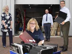 Police Crime Commissioner North Wales Andy Dunbobbin (RIGHT) visit to  Wales Recycle I.T , Llangefni to meet (from left) Deborah Mitchell, Rebekah Lowther  and Gareth Roberts .               Picture Mandy Jones