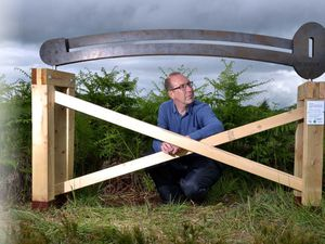 Andrew Howe, from Shrewsbury, with the 'Inclinometer' artwork created by Elizabeth Turner and Keith Ashford