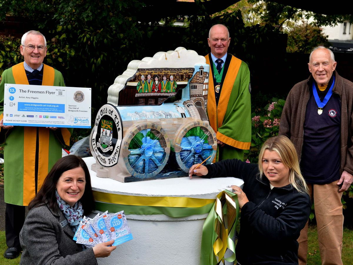 Front, Councillor Julia Buckley with artist Amy Higgins. Back, Robert Davies and Tony Head from the Guild of Bridgnorth Freemen, and Brian Jones, civil engineer from the Severn Valley Railway