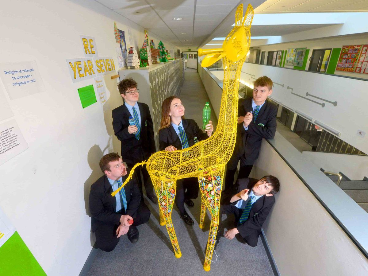 Olly Ruck 16, James Salter 15, Emily Kirkham 15, Charlie Beech 15 and Ethan McCabe 15 with Juicy Lucy the giraffe